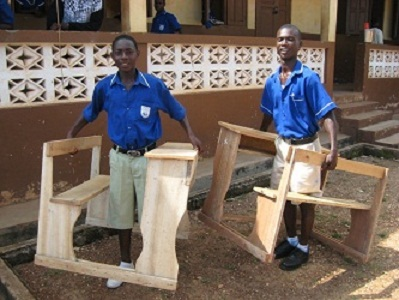 Boys carrying Anglican Desks